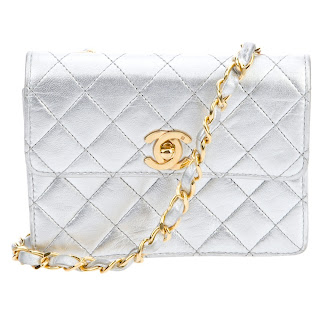 Vintage silver colored quilted Chanel bag with gold hardware