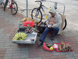 Vendor selling his meagre items.