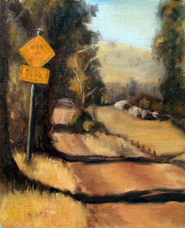 Oil painting of a yellow road sign beside a gravel road with shadows cast by trees, looking towards a distant hill.