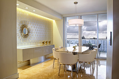 another angle of the classic white dining room reveals attractive mirror piece and another view to the harbor