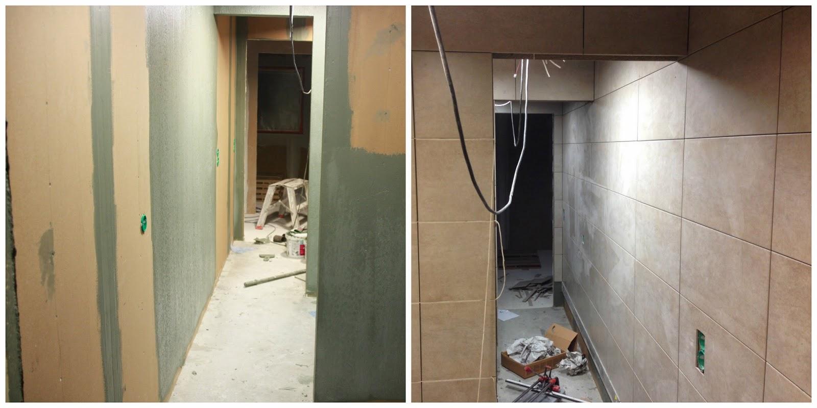 Yläkerran wc-suihku-wc-tila vedeneristettynä ja laatoitettuna