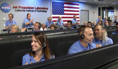 Curiosity MSL lands on Mars. Entry, Descent and Landing (EDL) team in blue shirts. Rejoice after parachute deployment. Control room at JPL, 6 August 2012. NASA/JPL.