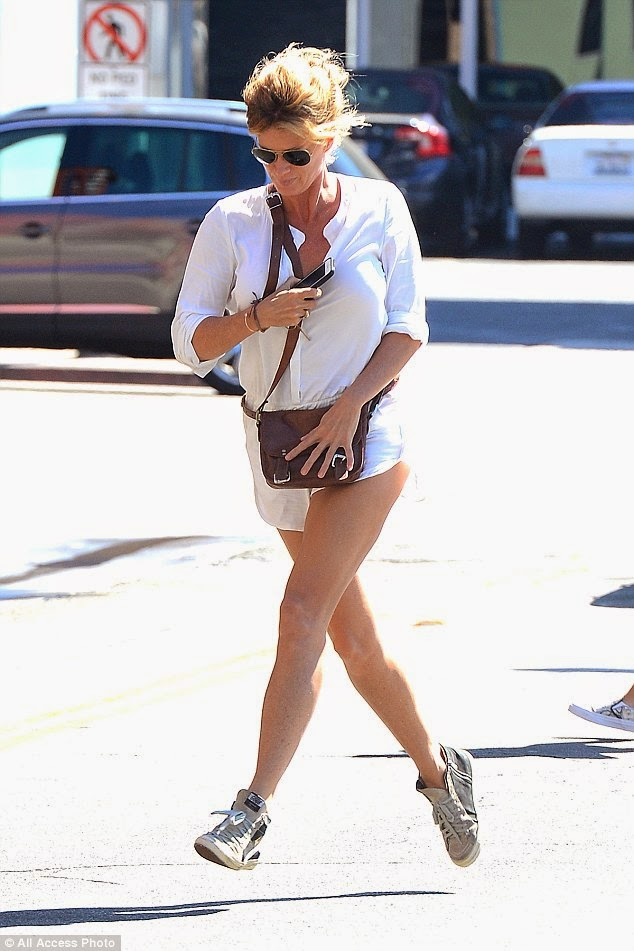 Rachel Hunter is obviously one fit lady, but recently she was snapped to run for another possible. Oh no! That's kind makes it hard to get our workout on as the 45-year-old jogged to and from Hugo's restaurant at West Hollywood on Wednesday, September 24, 2014.