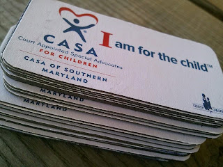 A pile of CASA card reading I am for the Child.