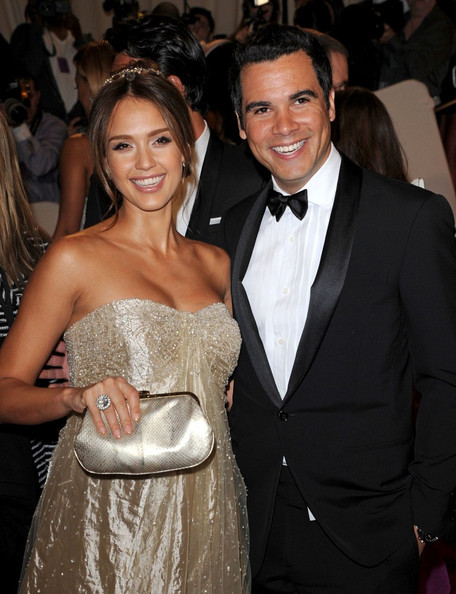 A pregnant Jessica Alba in a strapless gold  Ralph Lauren gown at the Met Gala