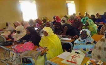 Women prepare for a literacy exam in Omdurman Sudan