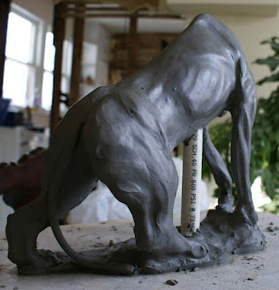 sculpting a lion, sculpting a clay mountain lion sculpture, sculpting a clay panther sculpture