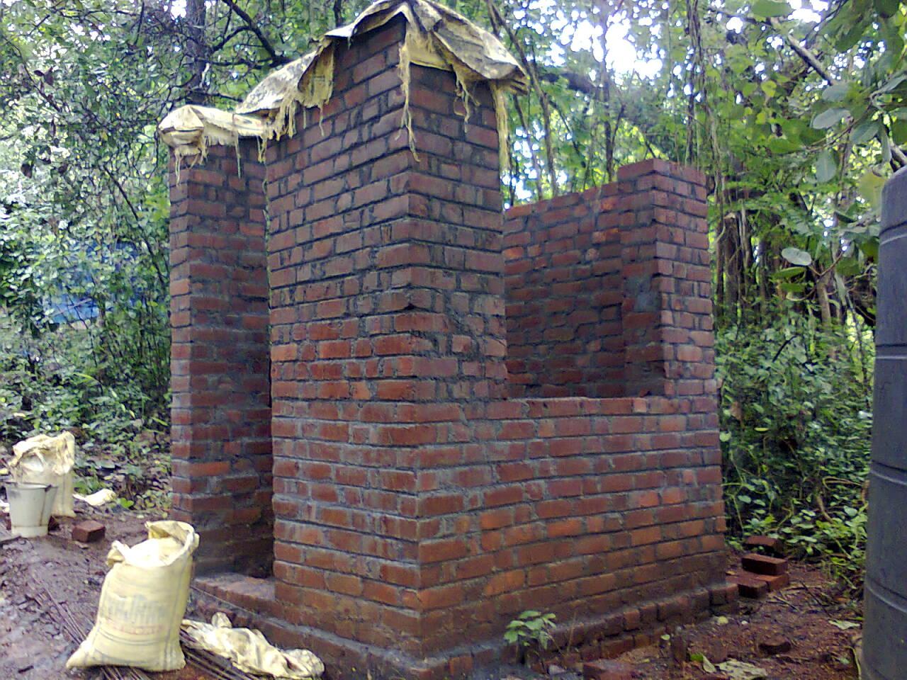 Shuttering work of villa b1 gf curved fountan brick work for Brick cabin