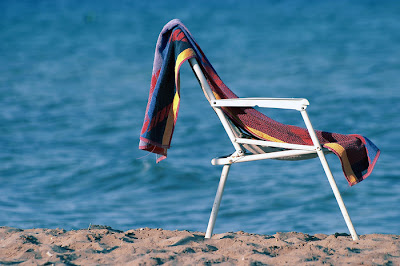 beach chair and towel at the beach
