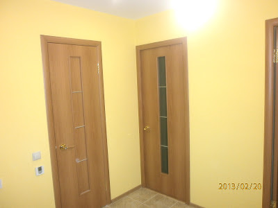 Ремонт в коридоре оштукатуривание стен двери пол
