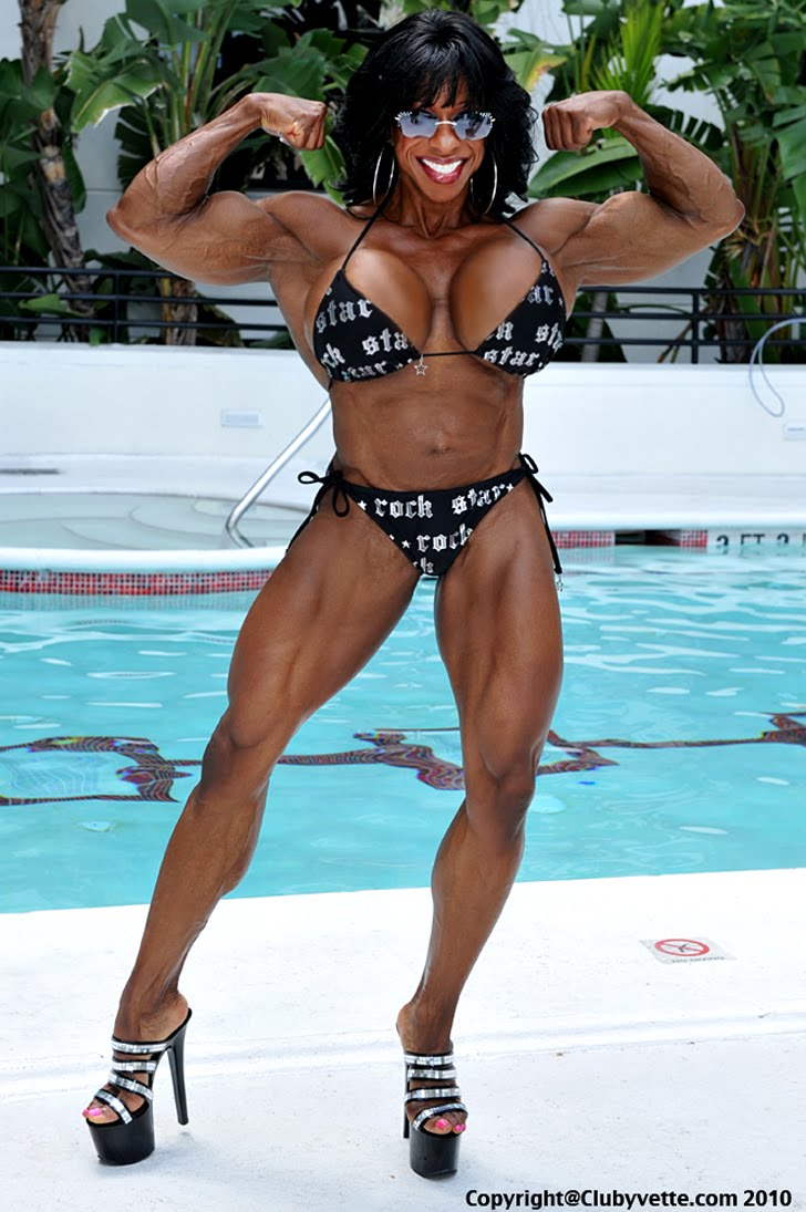 Yvette Bova Flexing Her Biceps In A Bikini By The Pool