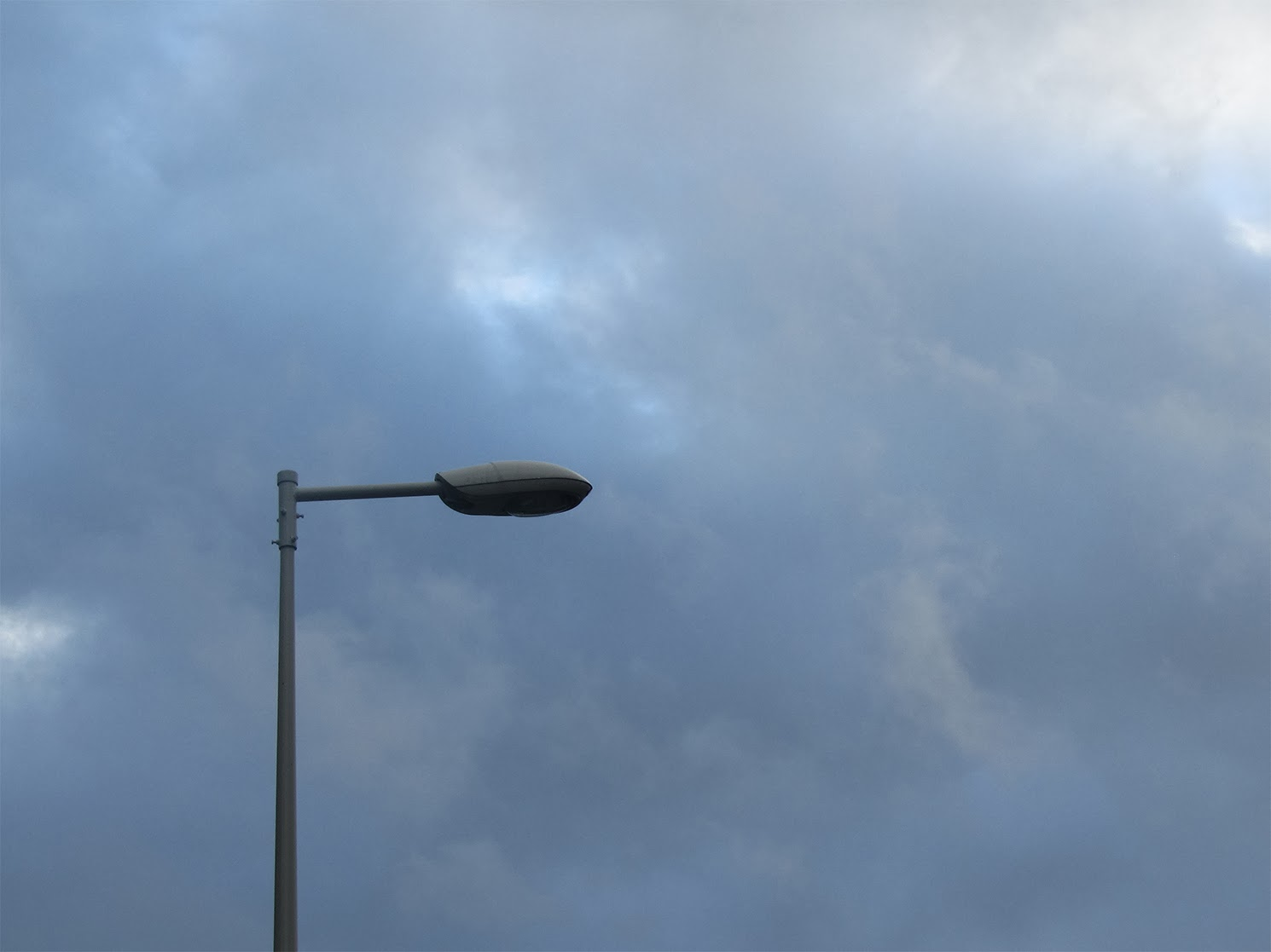 lamppost in front of threatening sky