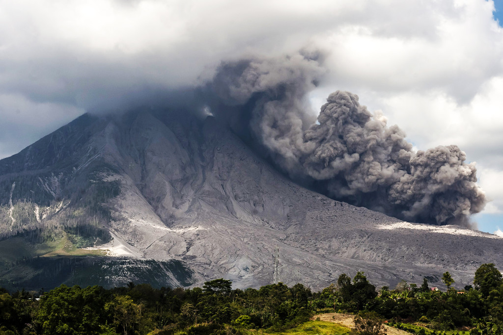 Thousands of residents near erupting Mount Sinabung are suffering respiratory diseases after...