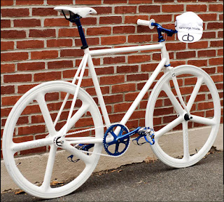 All white fixie with blue chrome