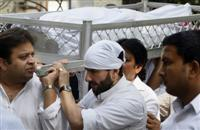 The body of Mansur Ali Khan Pataudi is carried by his son Saif Ali Khan during his funeral in New Delhi, India, Friday, Sept. 23, 2011