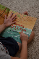 finding a letter in a book