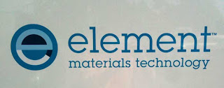 Element Materials Technology logo, blue black and white lower case e in a circle