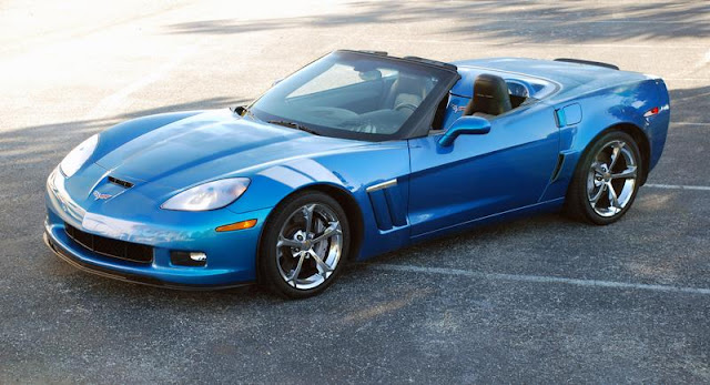 Front 3/4 view of blue 2011 Corvette GS parked with top down