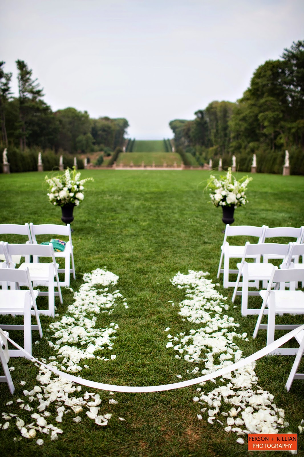 les fleurs : crane estate grand allele : person + killian photography : outdoor ceremony : black garden urn arrangements : white rose petals down aisle