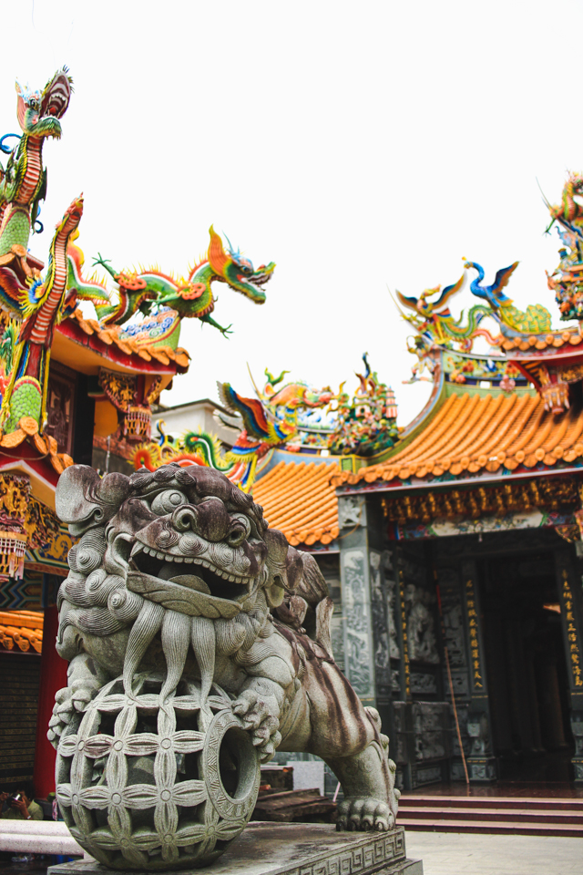 colorful dragons and stone guardians at a temple in Emei, Taiwan