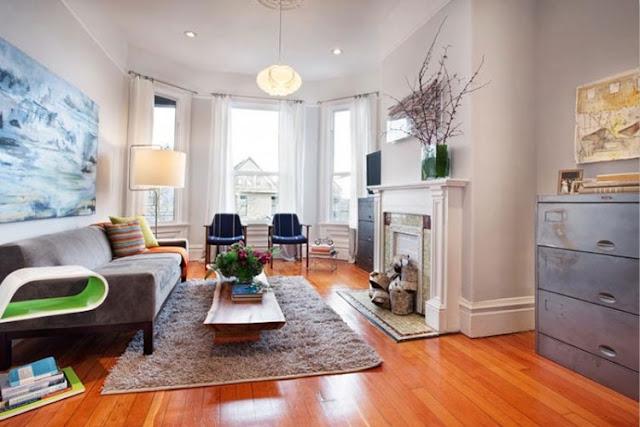 salon moderno y vintage con chimenea blanca y cajonera industrial