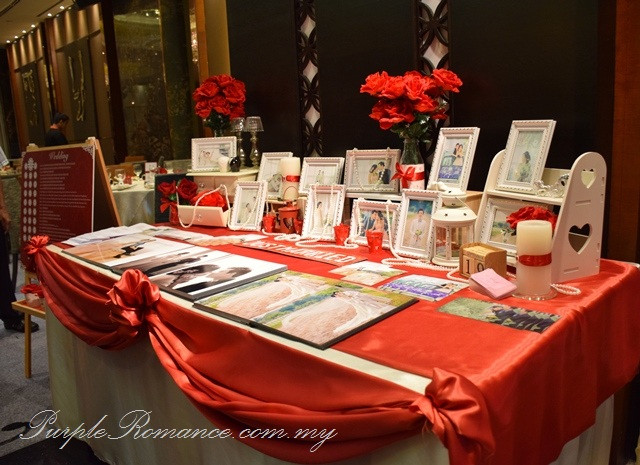 photo album table, wedding decoration, grand palace pavilion shopping mall, kuala lumpur, maroon red, roses, flower stands, backdrop printing, canvas, decorator, selangor, photographs package, VIP centerpiece, arch, pearls, photo booth, dessert bar, candy bar, reception table, love corner