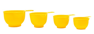 measuring cups in a fun color or design, like these bright yellow cups, make for a fun, easy gift