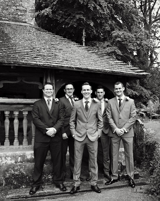 groom and groomsmen outside St Leonards in Bursledon