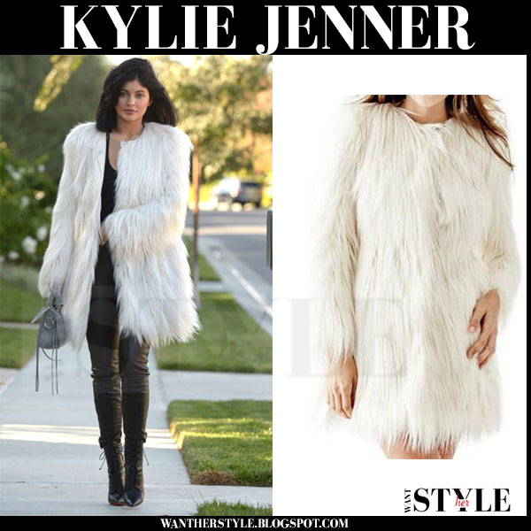 Kylie Jenner in white faux fur guess glam coat and black leather leggings what she wore streetstyle