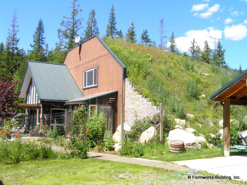 Earth sheltered homes rising popularity around the world for Geothermal house plans