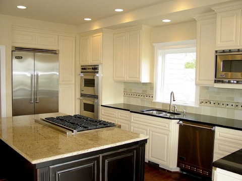 [Spacious white kitchen with metal elements]