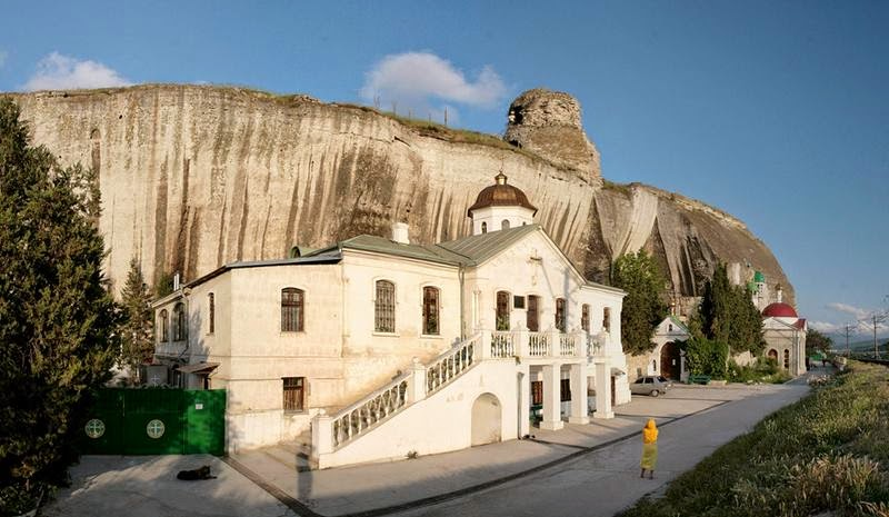 The Inkerman Monastery of St. Clement is a cave monastery in a cliff rising near the mouth of the Black River, in the city of Inkerman, administered as part of the sea port of Sevastopol.