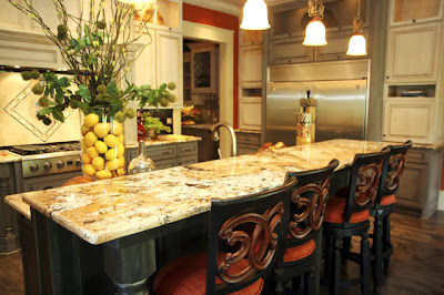 Luxury bright kitchen with bar and chairs