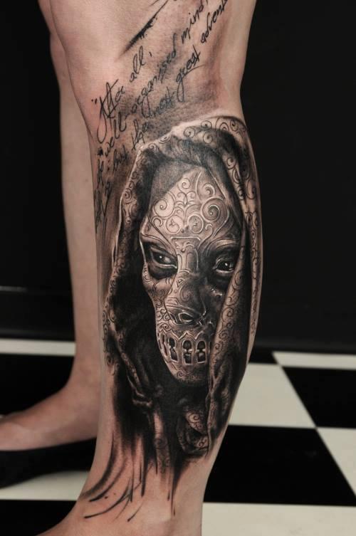 Realistic 3D iron mask tattoo on leg - Tattoo Mania