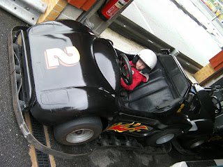 oversize racing helmet in go-kart