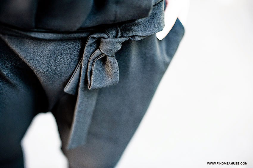 Close up detail of black ASOS jumpsuit
