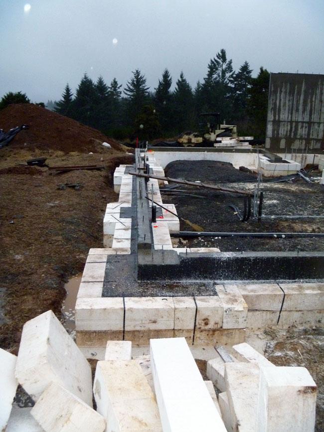 Karuna house 39 s concrete on foam passive house innovation for Foam concrete house construction