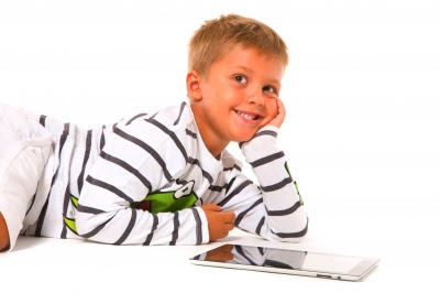 NAMC Montessori classroom computer applications boy using tablet app