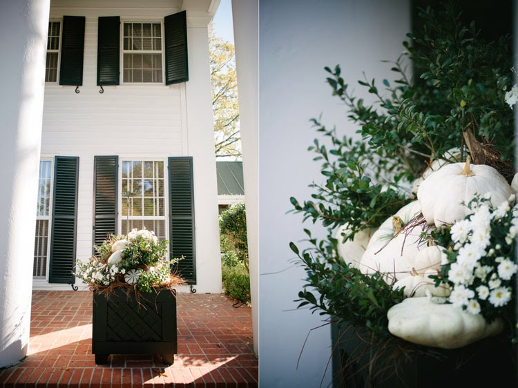 pumpkin planters on Mississippi mansion brick front porch
