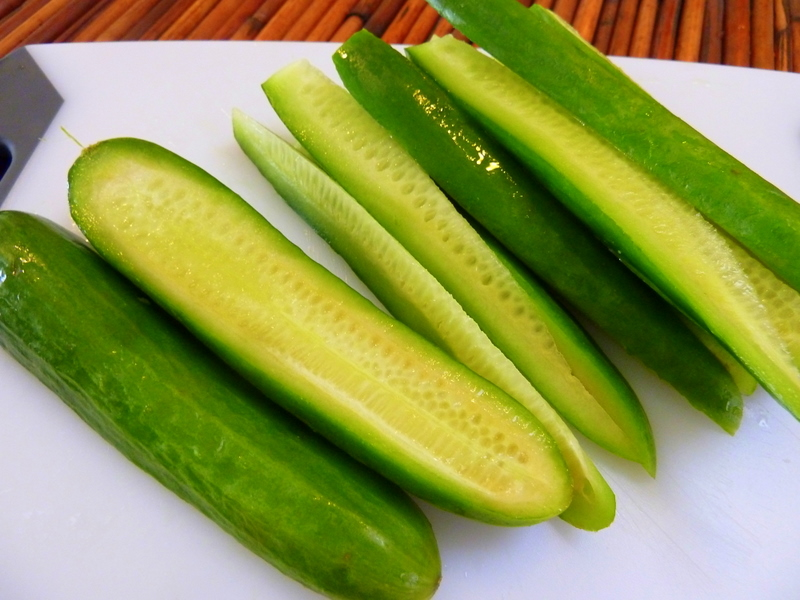 ... and slice the cucumbers, length wise, in half, then in quarter slices