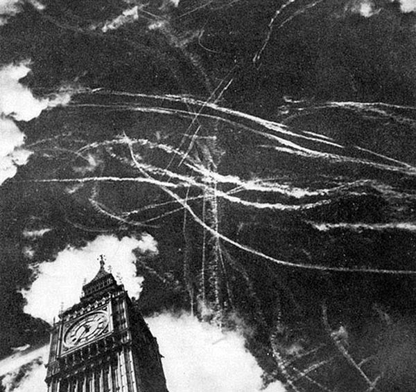 Rarest Historical Photos, That you can Never Forget. - Picture showing the dogfight between German and British planes, and The London sky after a bombing in the year 1940