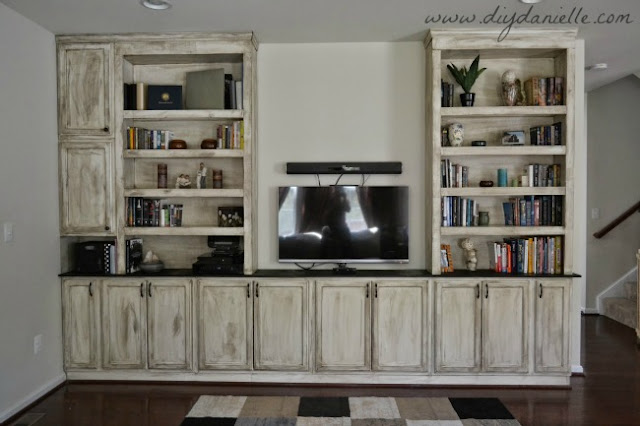 Built-In bookshelves, storage, and entertainment center: lights off.