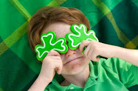 child with shamrocks montessori activity ideas st. patrick's day