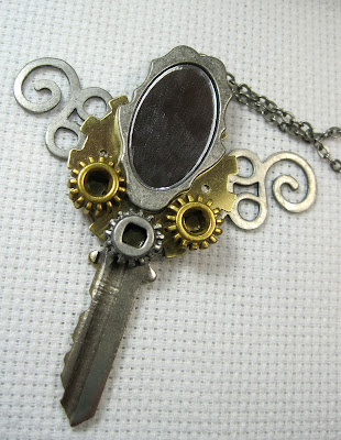Fancy steampunk style altered key pendant