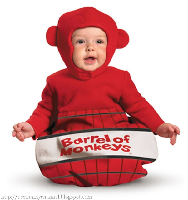 A child dressed as red monkey