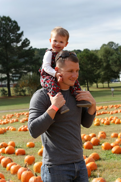Maddie on Daddy's shoulders at the pumpkin patch