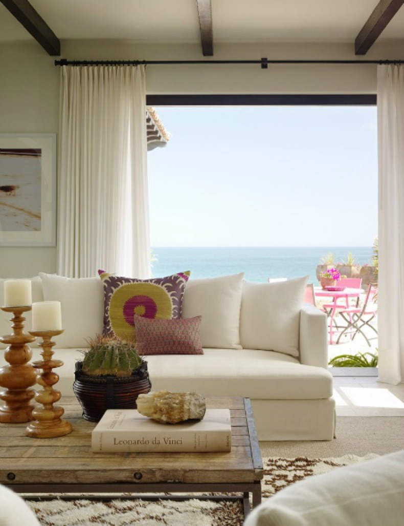 Coastal living room with white uphosltered sofa and ocean view