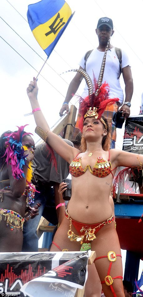 Rihanna was spotted today getting her carnival on,  in her home country of Barbados celebrating Kadooment Day.