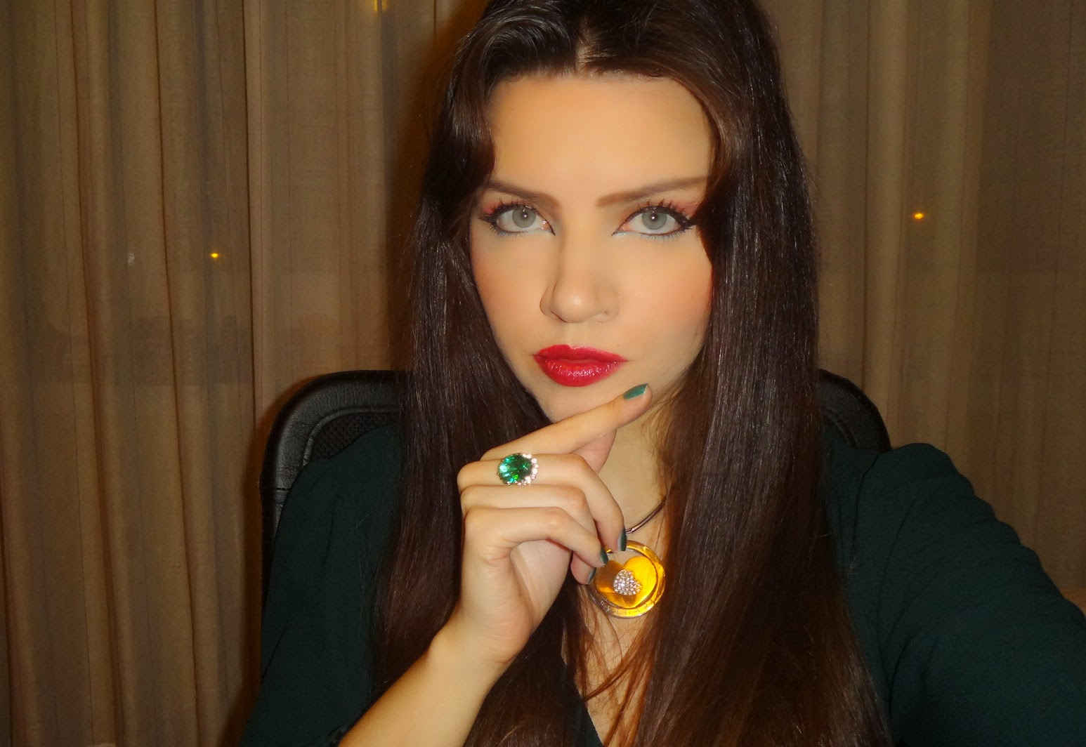 Look of the Day: Green jumpsuit, Chanel red lips and emerald green ...