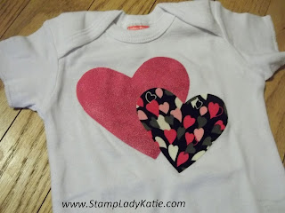Baby Onsie made with the Framelits Big Shot Hearts and Stampin'UP! Iron-on Fabric Adhesive. Made by StampLadyKatie